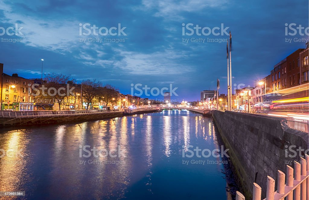 Hapenny bridge in Dublin Ireland over river liffey stock photo