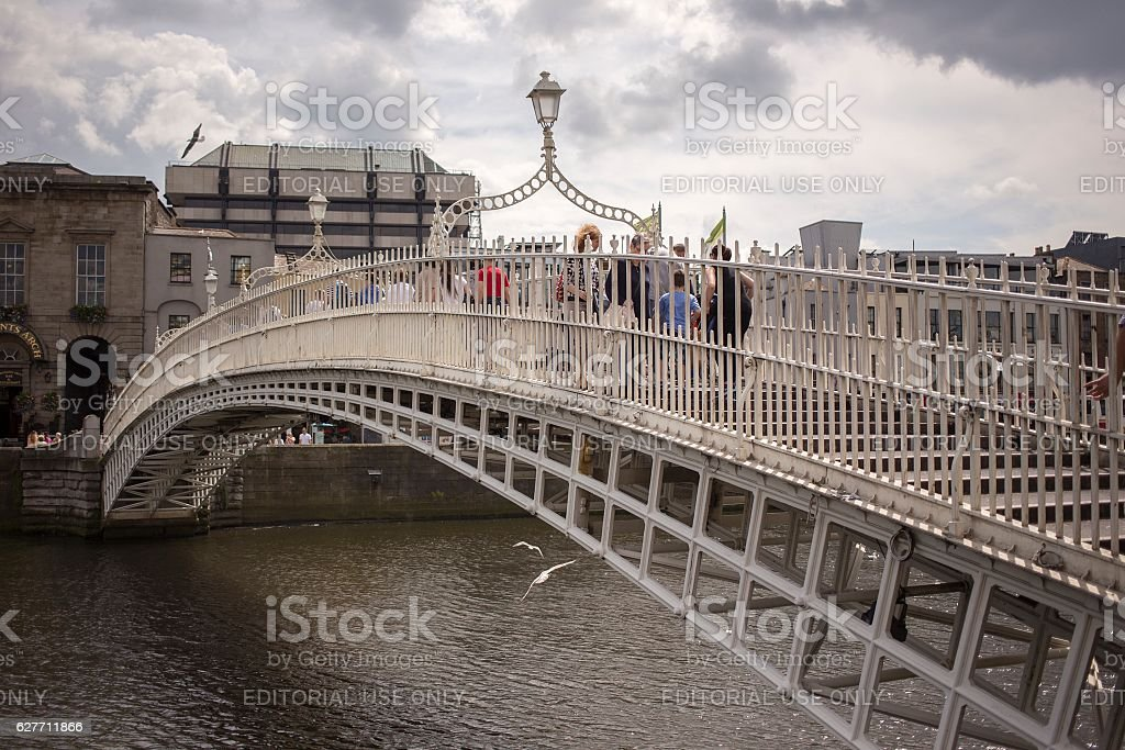 Ha'penny Bridge over Liffey river in Dublin, Ireland stock photo