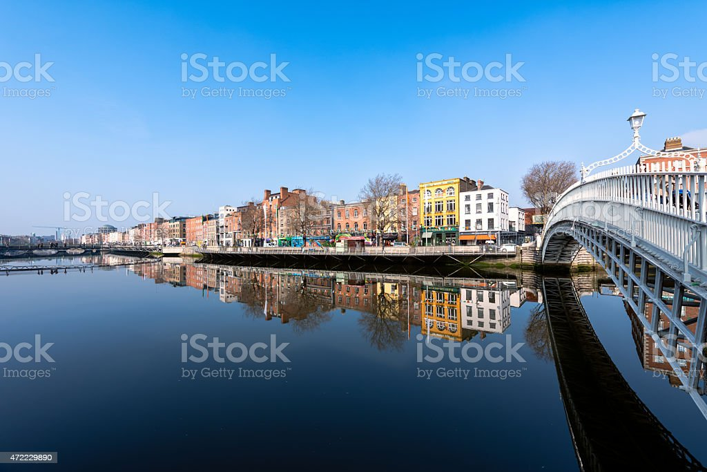 Hapenny Bridge reflecting in the river in Dublin stock photo