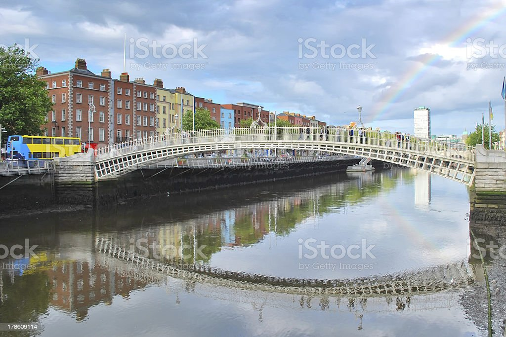 Ha'penny pedestrian bridge with rainbow stock photo