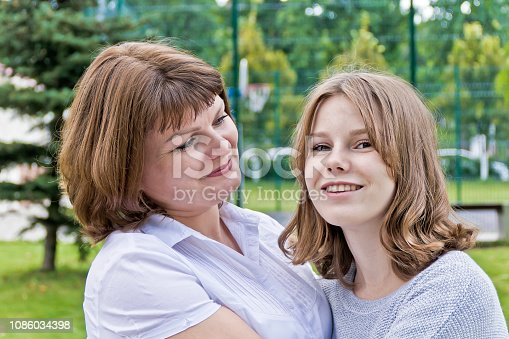 istock Happiest mother and daughter fourteen years old 1086034398