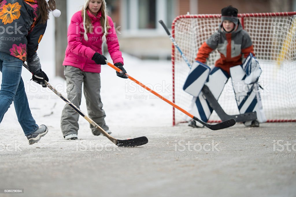 Happily Playing Hockey on the Street stock photo