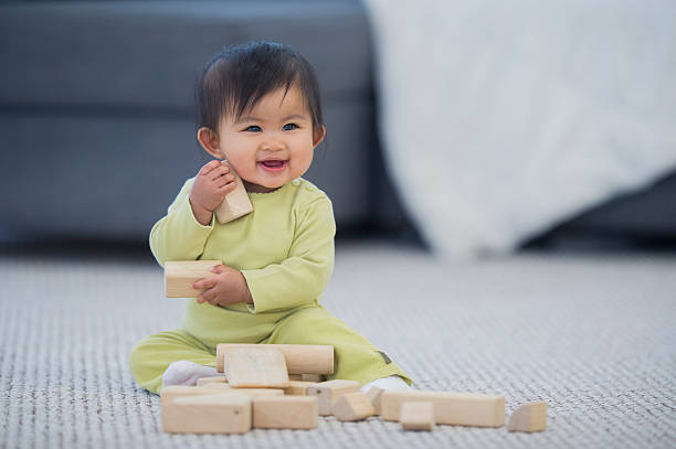 Happily Playing with Wood Blocks stock photo