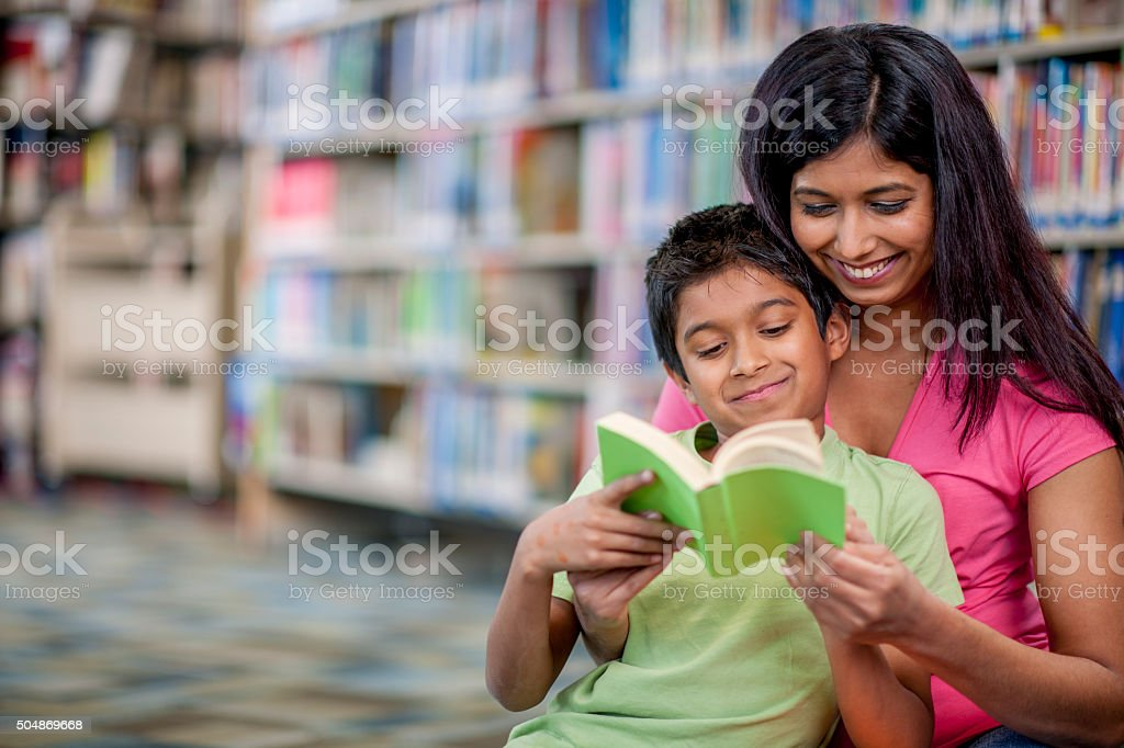Happily Reading a Book Together stock photo