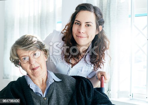 Happily Smiling Old Lady With Her Friendly Attendant Stock Photo & More Pictures of 1920-1929