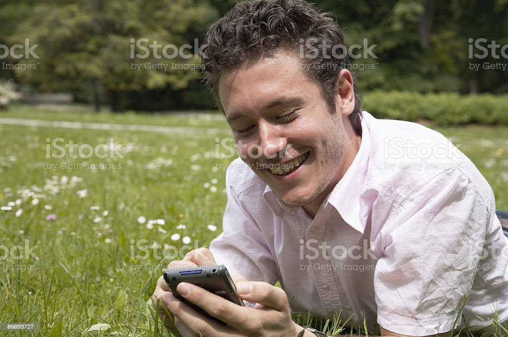 Happily Working on a PDA royalty-free stock photo