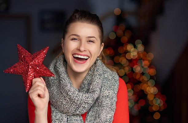 happiness and celebration of christmas - schal mit sternen stock-fotos und bilder