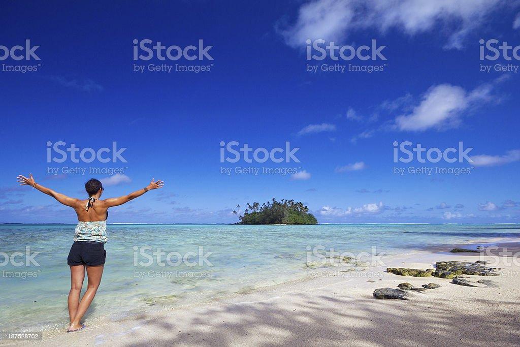 Happiness and Freedom - Woman on a beautiful idyllic beach stock photo