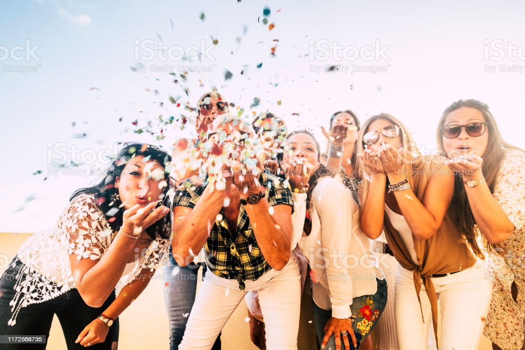 Happiness and joyful concept - group of happy women people celebrate. all together blowing confetti and having fun - new year eve and party event for group of beautiful girls -white clear  background - Royalty-free 2020 Foto de stock
