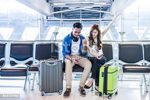 istock Happiness Asian couple traveler holding the passport with suitcases in modern an airport, travel and transportation with technology concept. 843737560