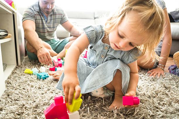 happiness british family on the living room - teppich englisch stock-fotos und bilder