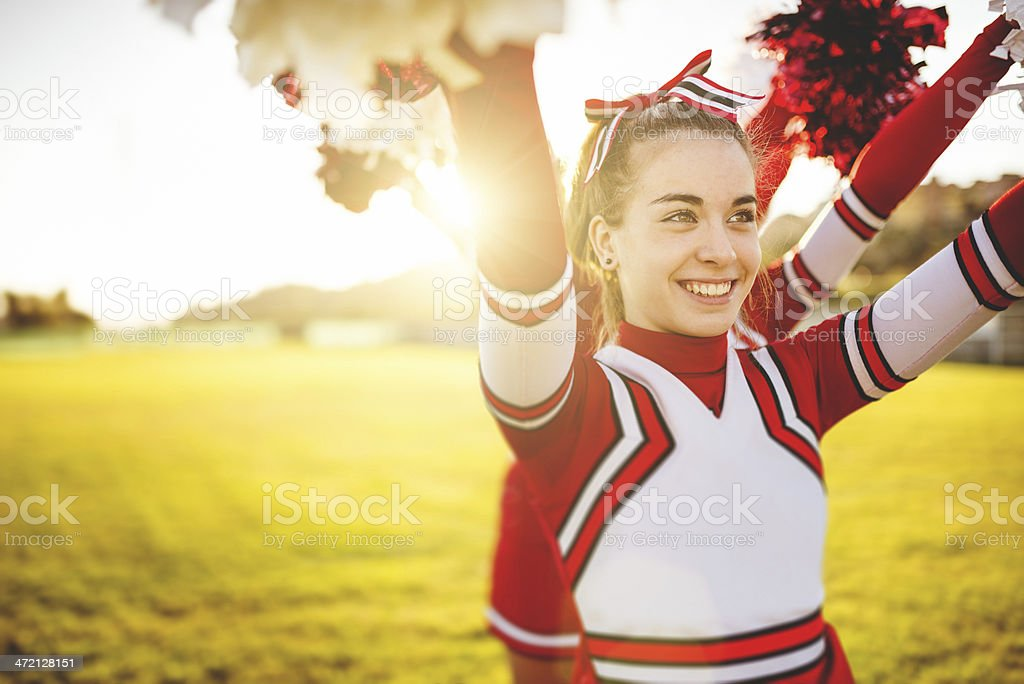 Happiness cheerleader posing with pon-pon stock photo