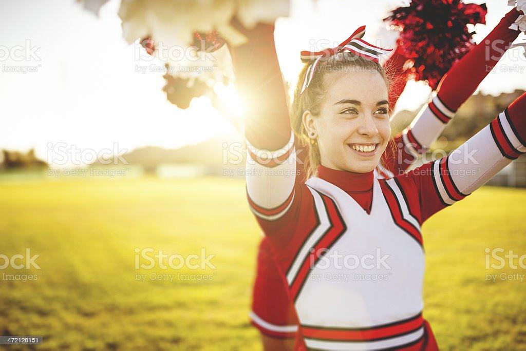 Happiness cheerleader posing with pon-pon stock photo