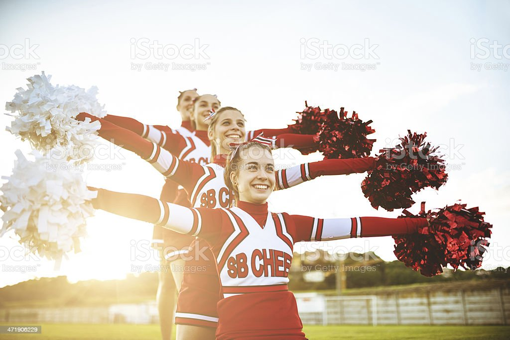 Happiness cheerleaders posing with pon-pon royalty-free stock photo