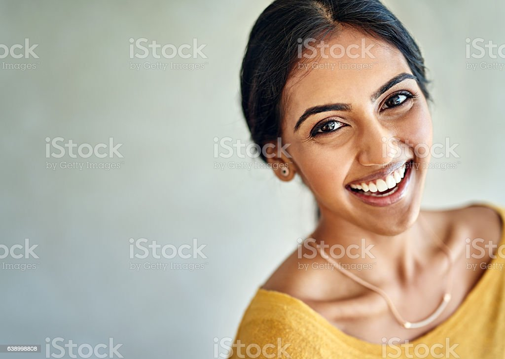Happiness comes to her easily and effortlessly stock photo