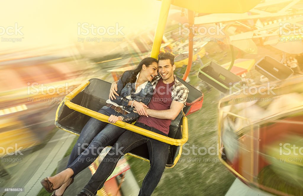 Happiness couple riding on ferris wheel stock photo