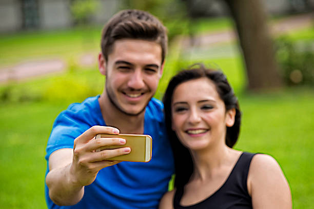 happiness couple taking a selfie - beautiful college girl pics stock photos and pictures