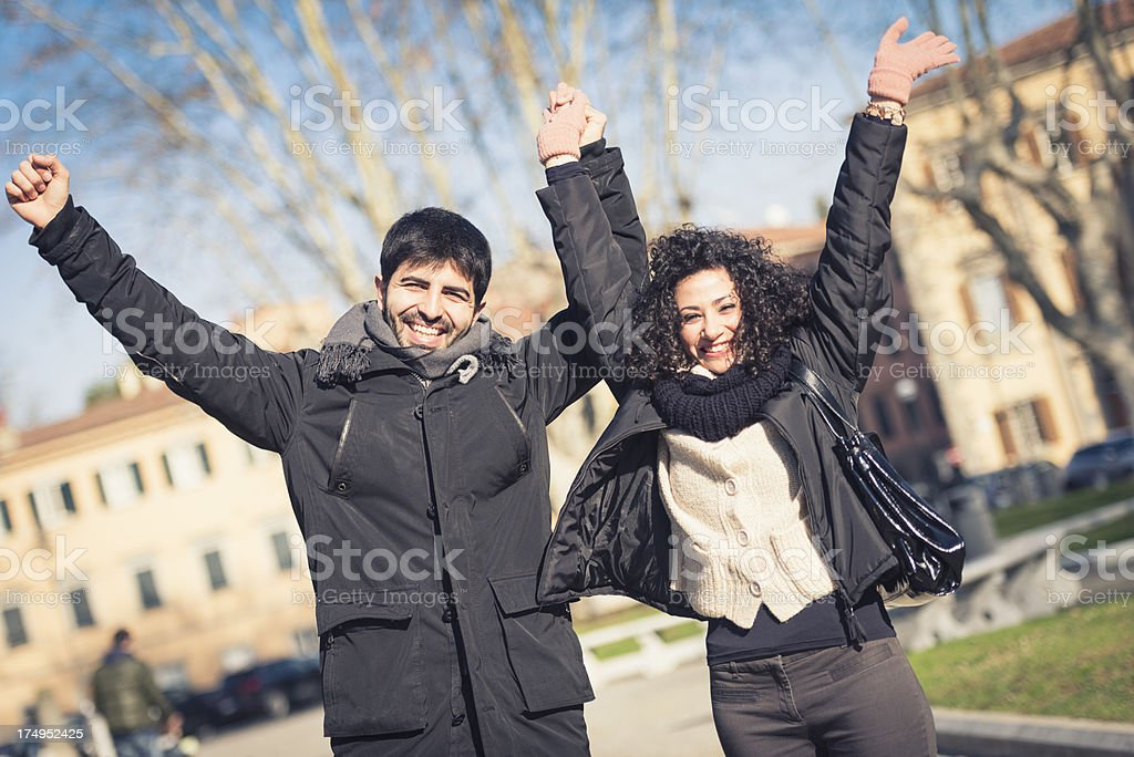 happiness couple with arm raised on street royalty-free stock photo