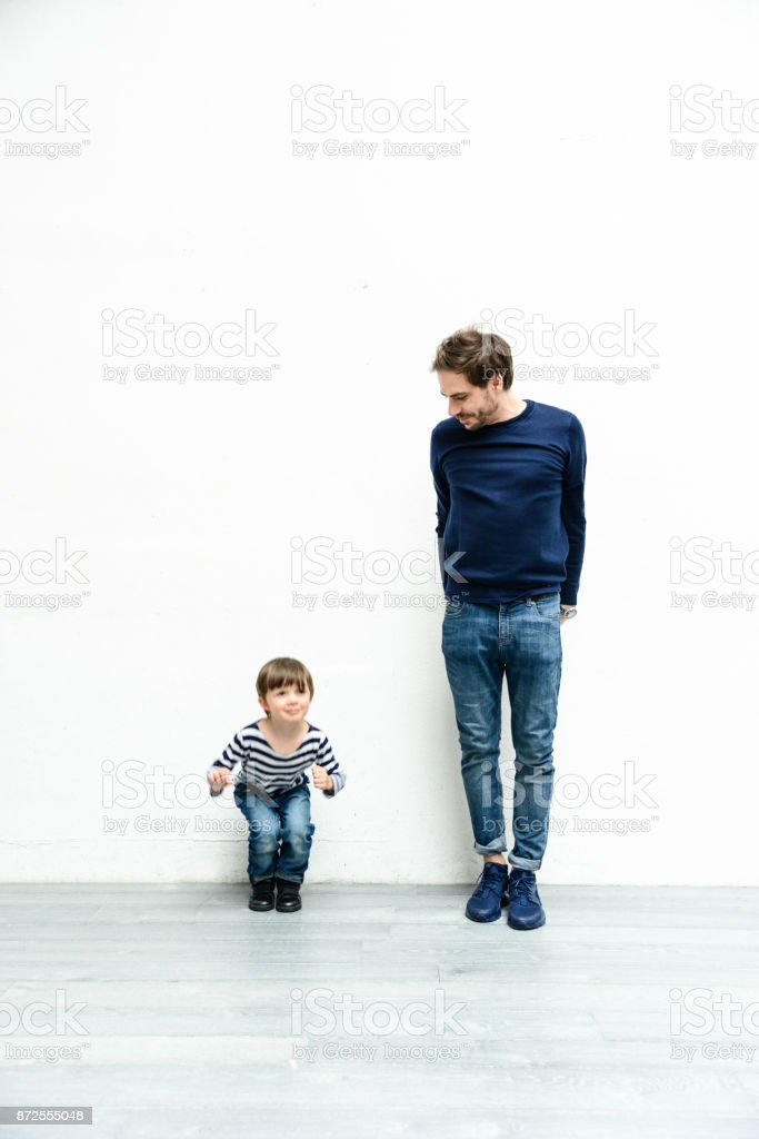 happiness family on white wall stock photo