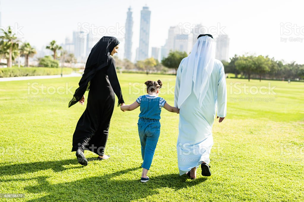 happiness family walking in the park in dubai stock photo