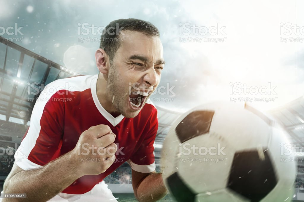 Happiness football player after goal. stock photo