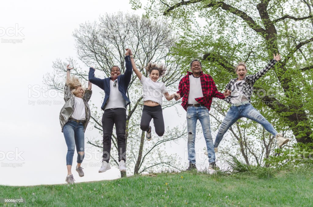 happiness, freedom, motion, diversity and people concept stock photo
