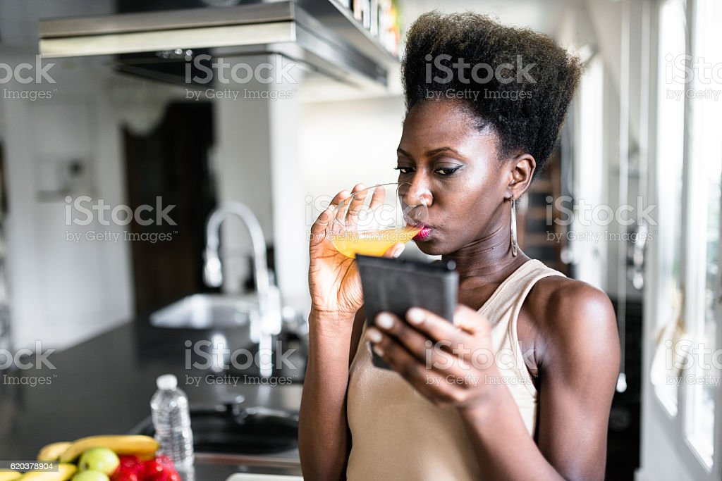 happiness french woman drinking the orange juice on the phone foto de stock royalty-free