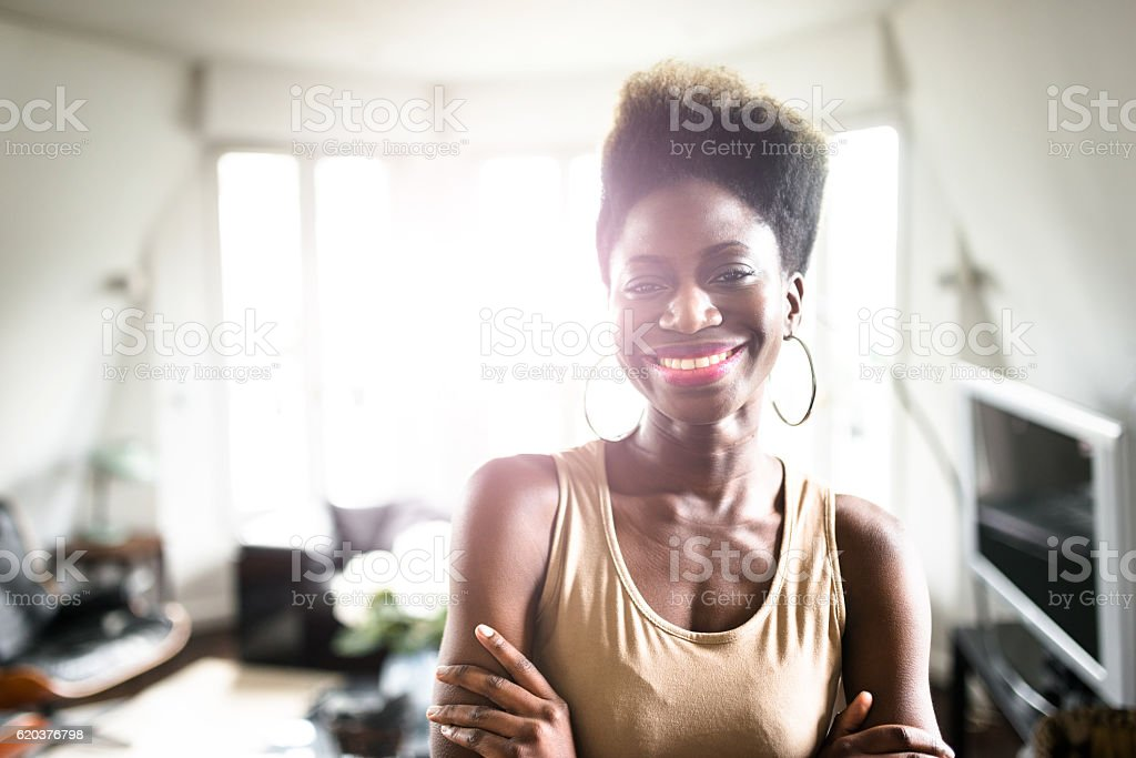 happiness french woman standing in the kitchen zbiór zdjęć royalty-free