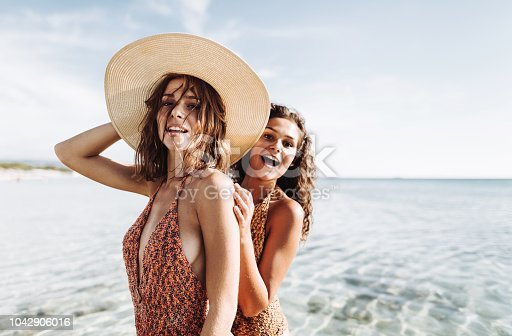 happiness friends at the seaside with panama hat