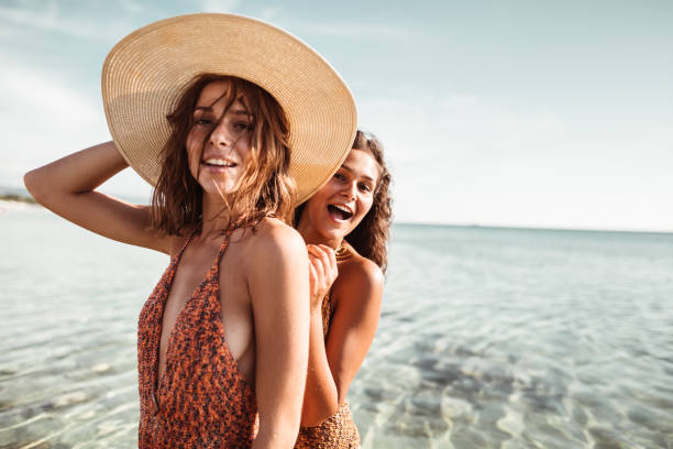 happiness friends at the seaside with panama hat stock photo