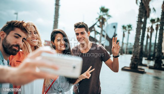 861023492 istock photo happiness friends taking a selfie embracing  outdoors 1248297204