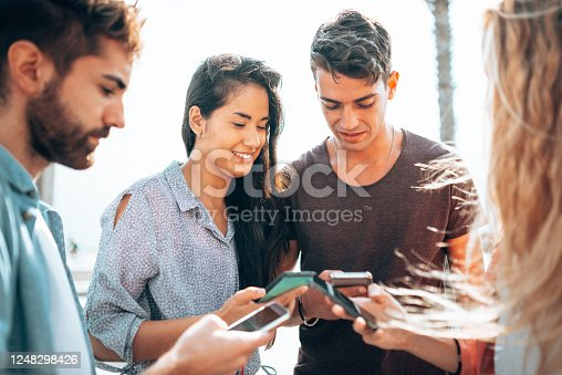 861023492 istock photo happiness friends taking a selfie embracing  outdoors 1248298426