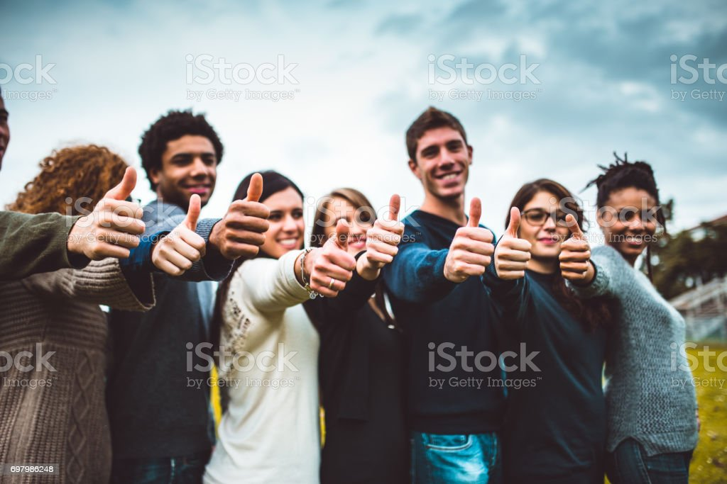 happiness friends thumbs up for victory stock photo
