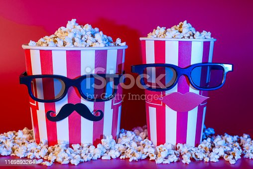 istock Happiness friendship party concept. Full length photo of style stylish fashionable modern creative pair of looking like people two striped containers with fresh delicious popcorn isolated background 1169893264