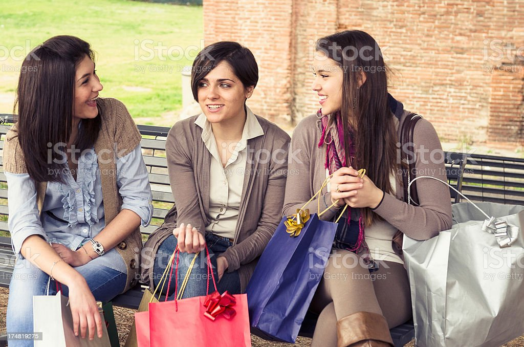 Happiness girl after shopping talking sitting on bench royalty-free stock photo