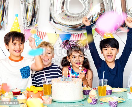 502282224 istock photo Happiness group of cute and adorable children having birthday party 669846998