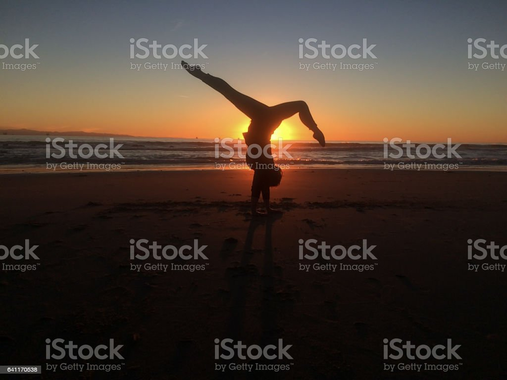 Happiness in Nature gymnastics on the beach stock photo