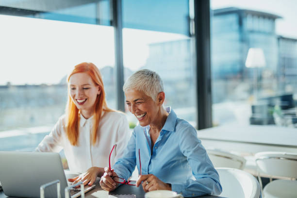 Happiness inspires productivity Two businesswomen enjoying working together age contrast stock pictures, royalty-free photos & images
