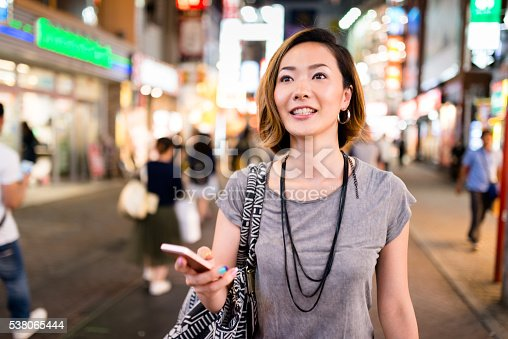 istock happiness japanese woman enjoy the night in tokyo 538065444