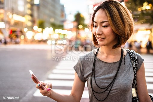 istock happiness japanese woman enjoy the night in tokyo 607505946