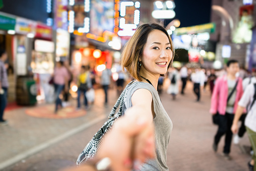 istock happiness japanese woman in tokyo walking together 544318838