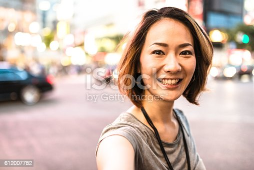 istock happiness japanese woman on the phone 612007782