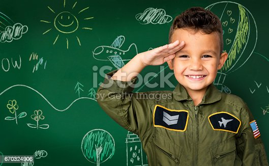 istock Happiness little boy with pilot dream job smiling 670324906