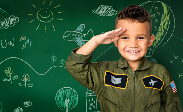 happiness little boy with pilot dream job smiling - saluting stock photos and pictures