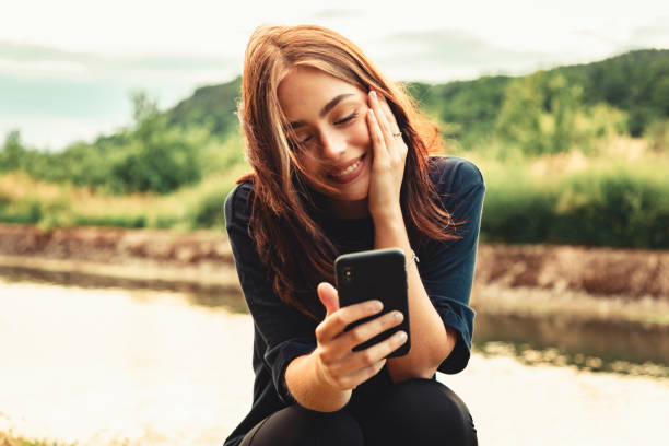 Happiness Lucky Smiling Young Woman On Video Call stock photo