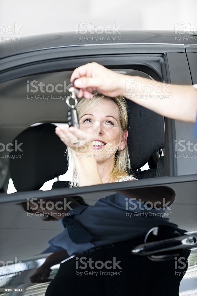 Happiness of buying a new car royalty-free stock photo