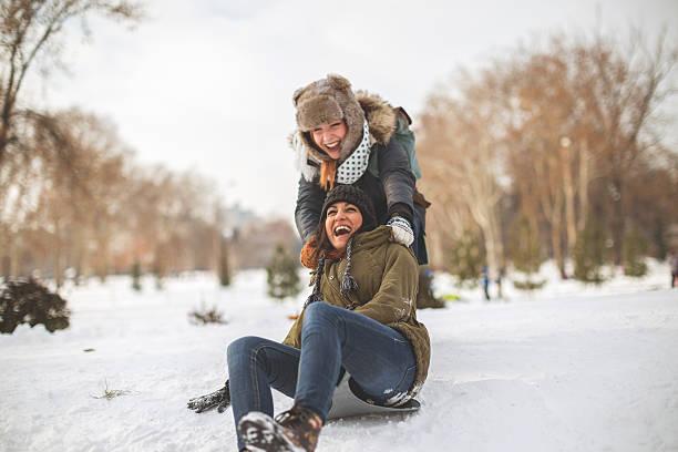 happiness on snow - schneespiele stock-fotos und bilder