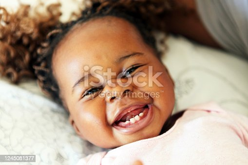Cute African girl smiling at the camera