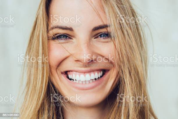 Portrait of young woman with beautiful smile