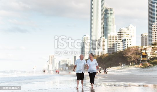 happiness senior couple running happiness on the beach